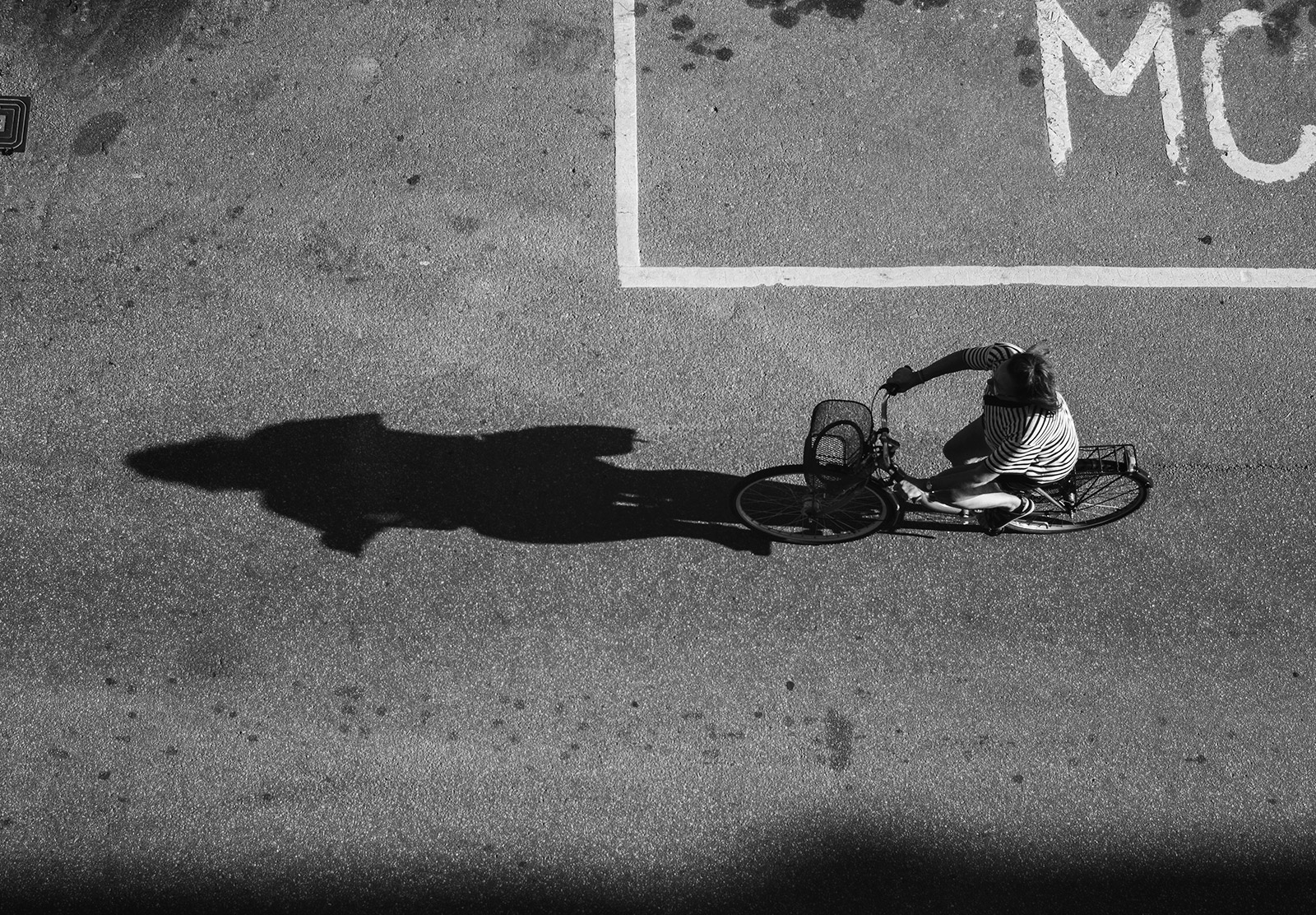 Cyclist with shadow