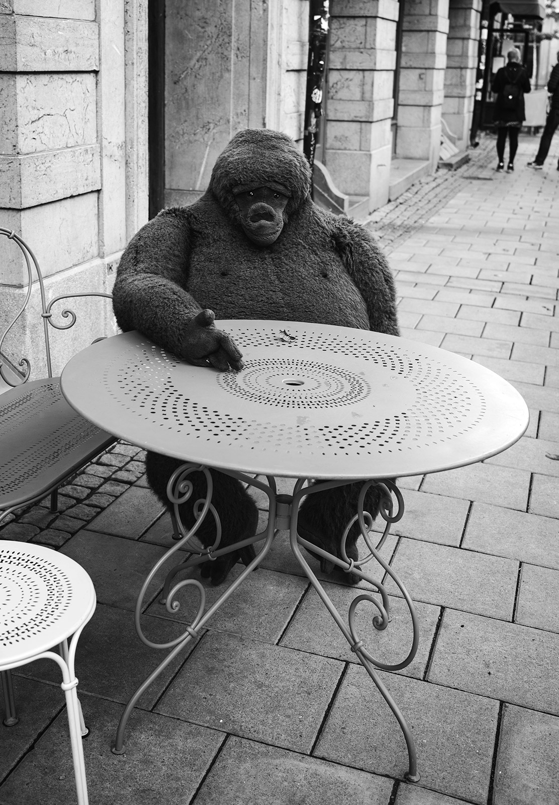 Gorilla sitting at table