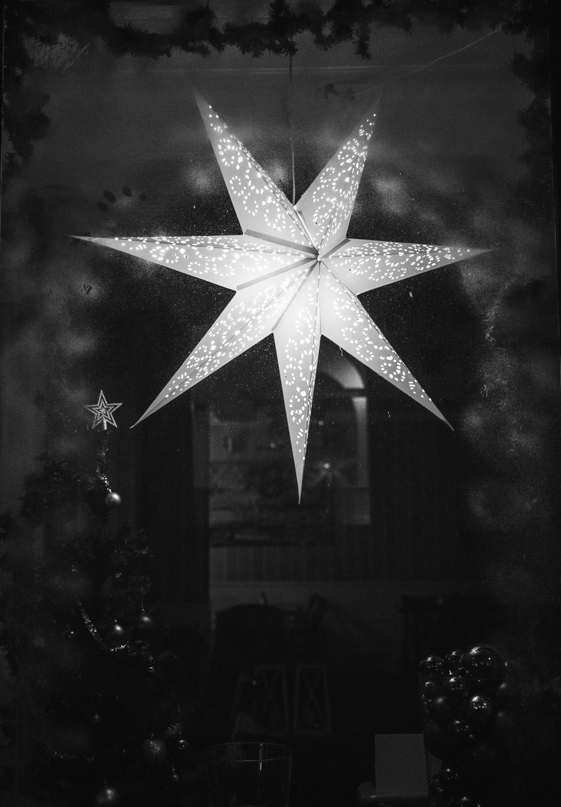 Star hanging in window