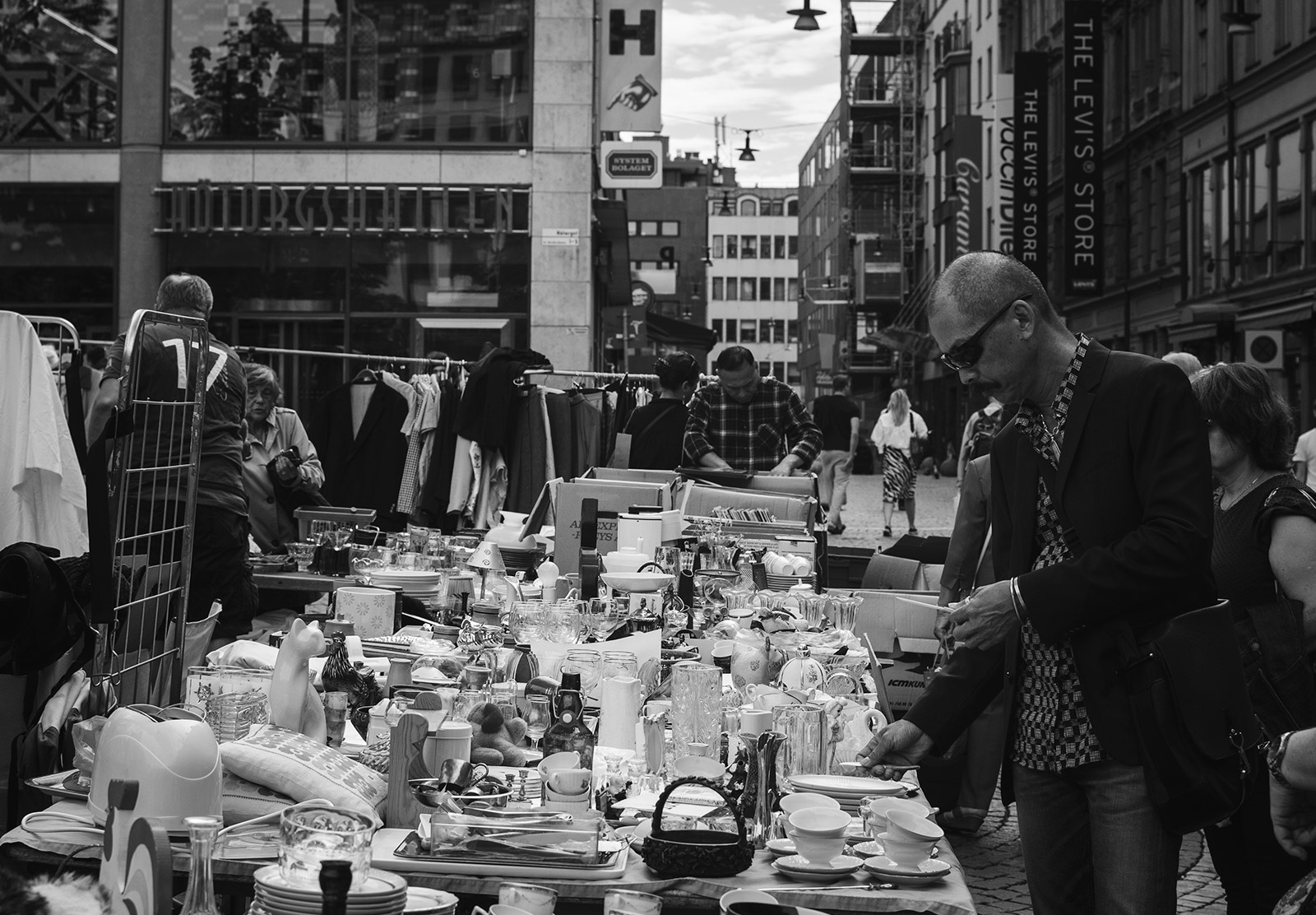 Man looking at a market stall
