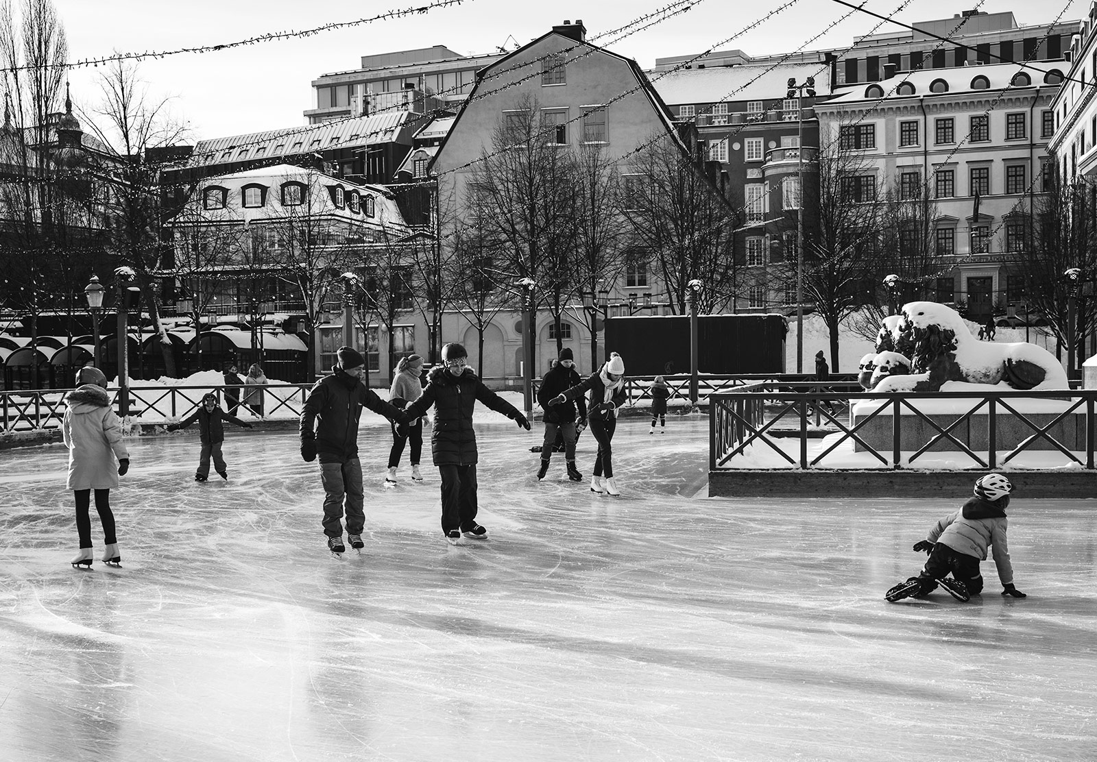 People skating on ice rink