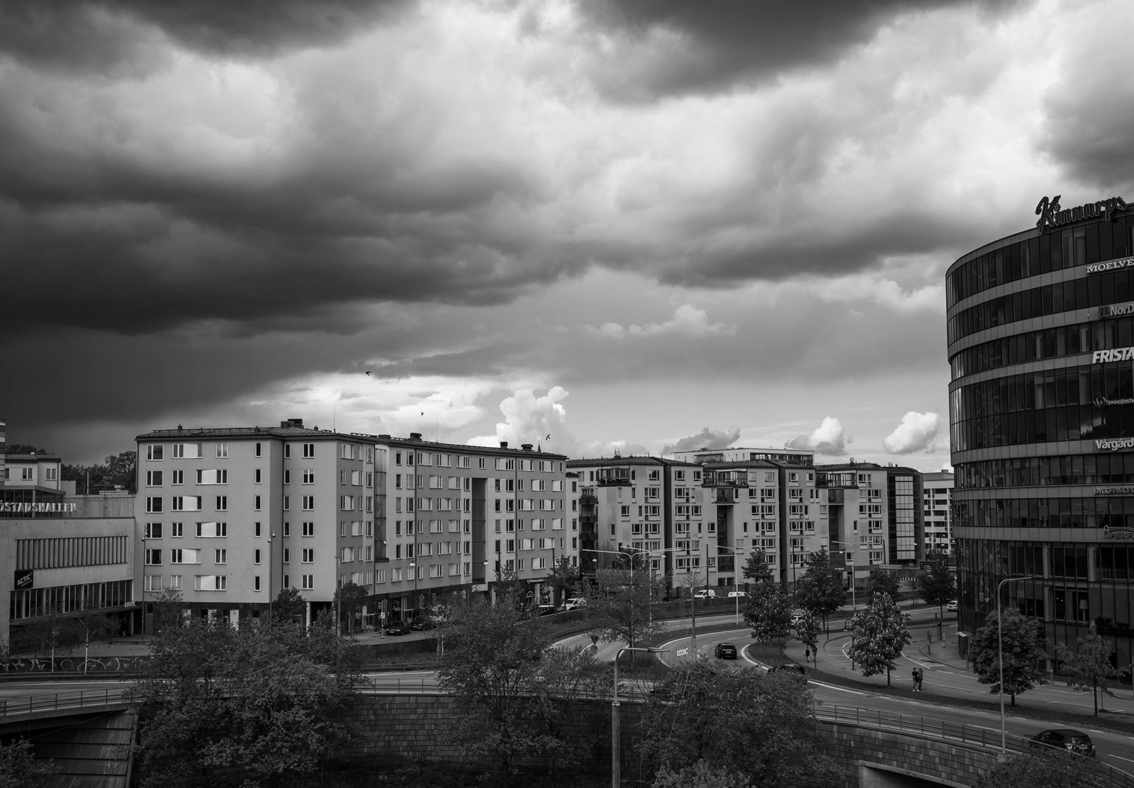 Dark cloud over buildings