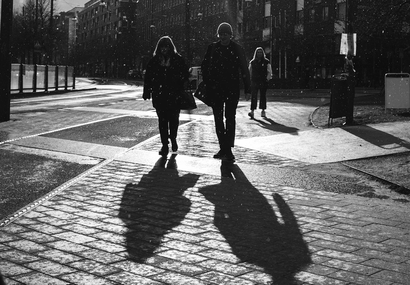 People walking in snow and sun