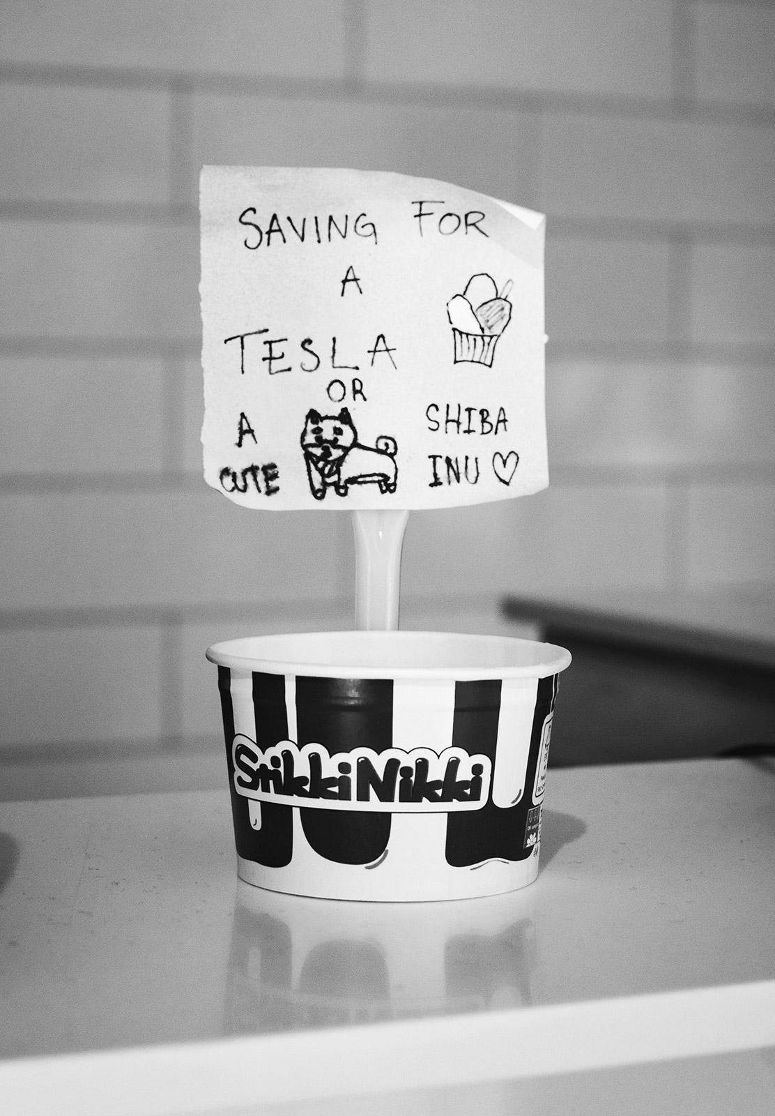 """""""Saving for a tesla"""" tip jar"""