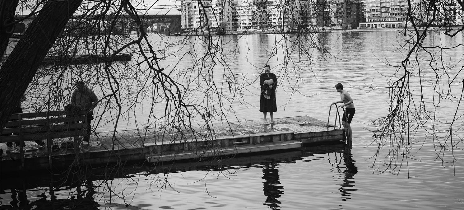 Boy stepping into water