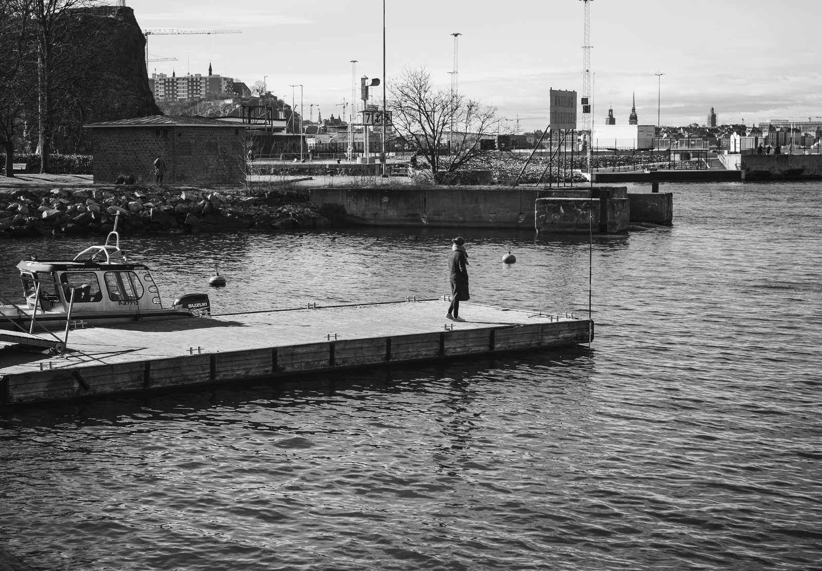 Woman waiting for a boat