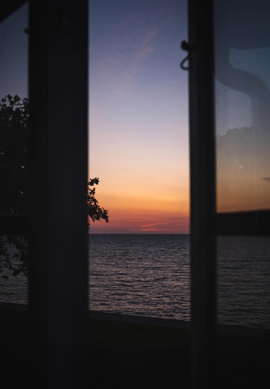 Sunset through open window