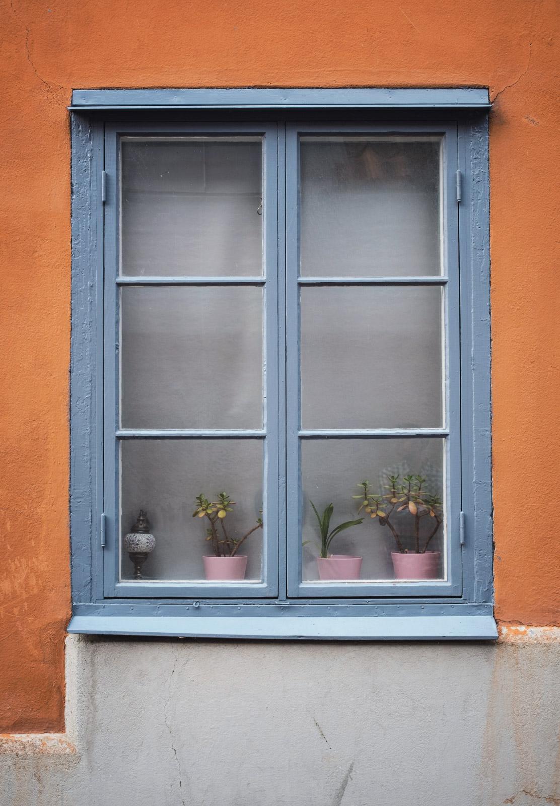 Blue window on orange wall