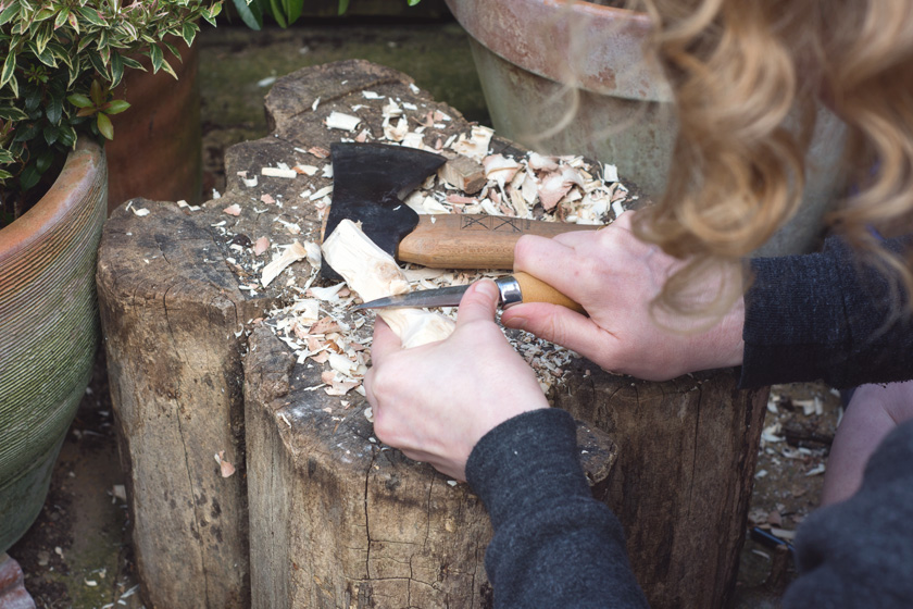 Whittling on tree stump