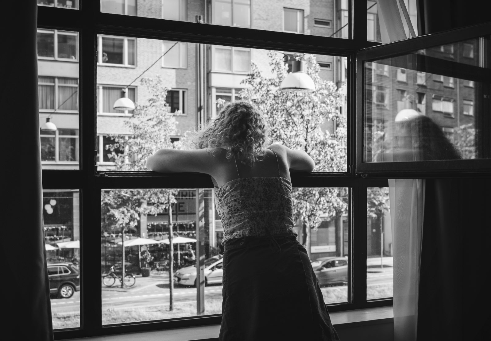Woman leaning out of window