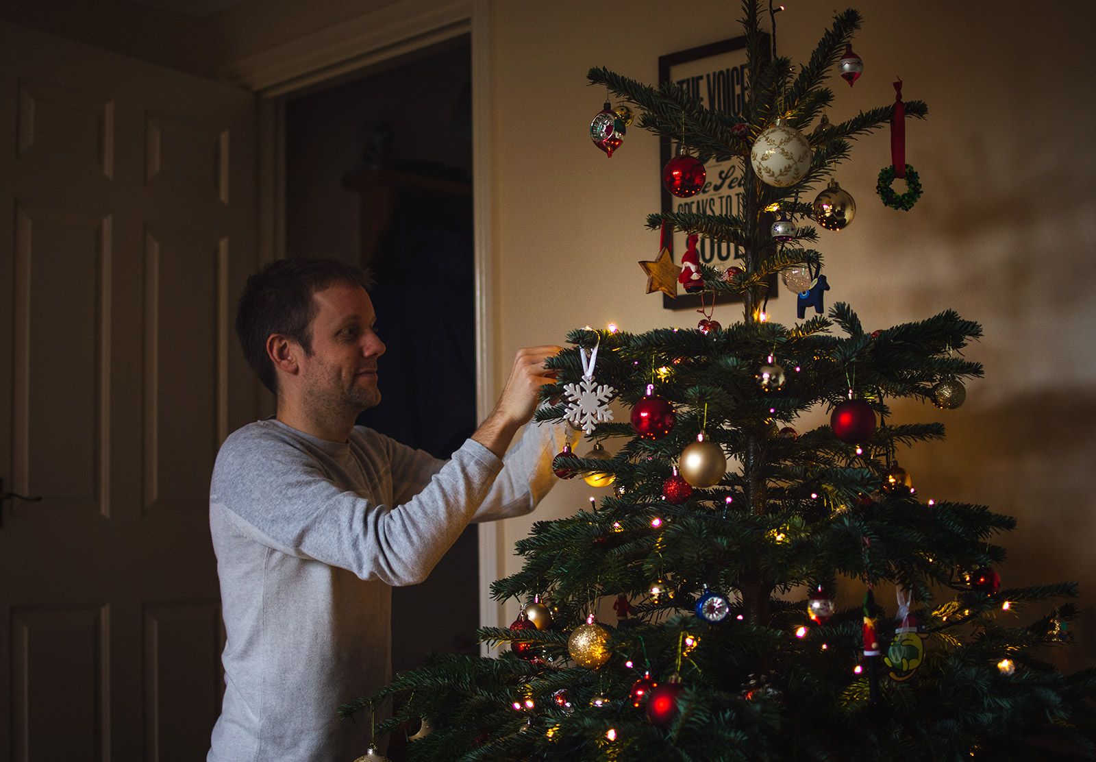Man decorating tree