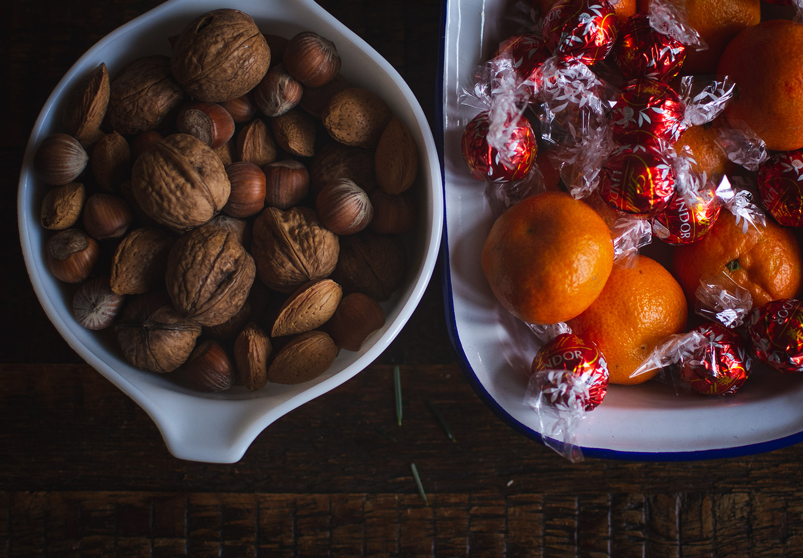 Bowls of nuts and satsumas
