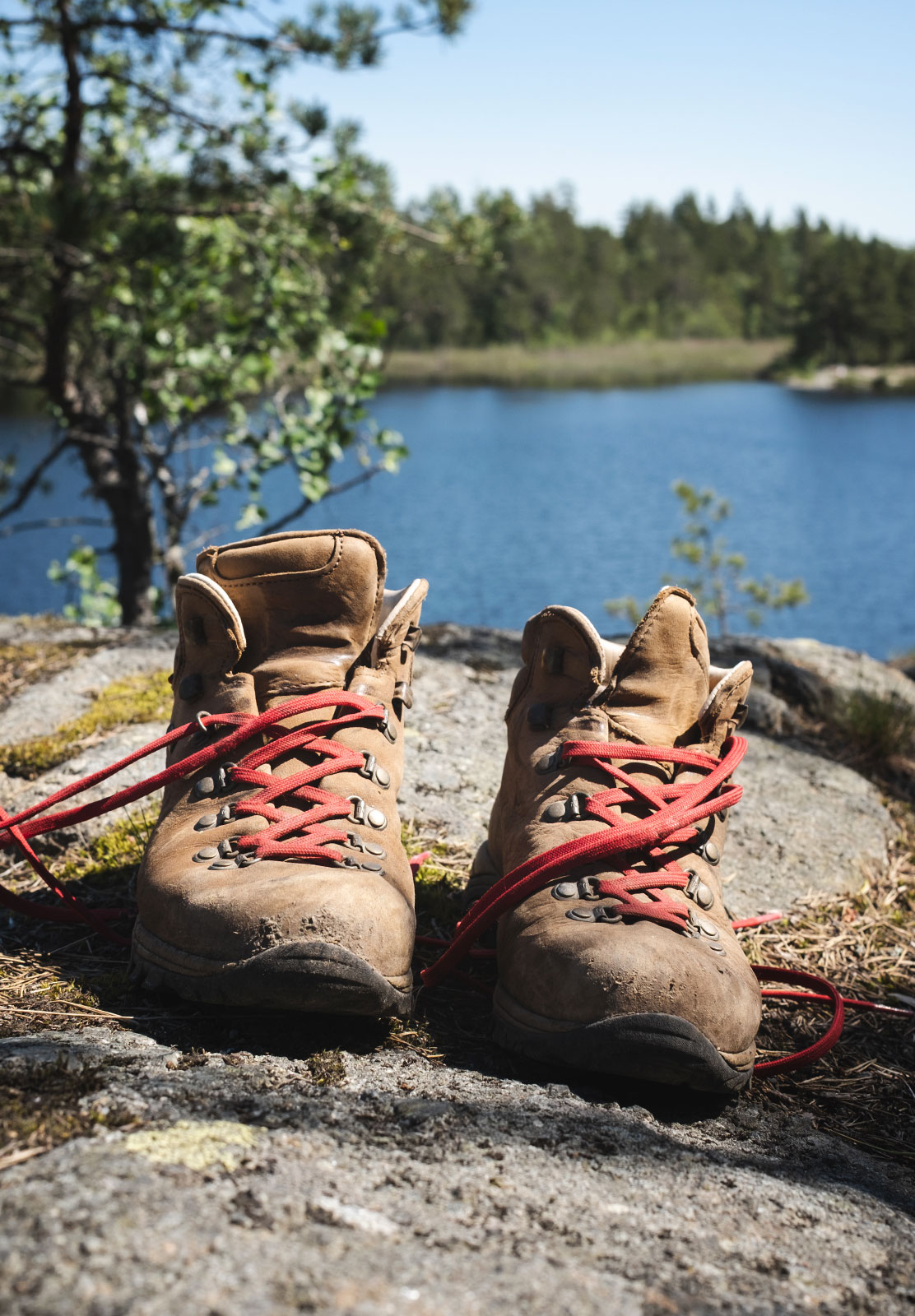 Boots resting on a rock